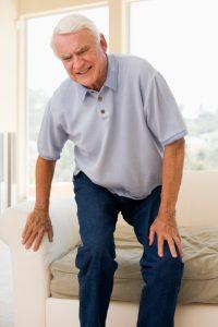 Senior Man Trying To Sit Down